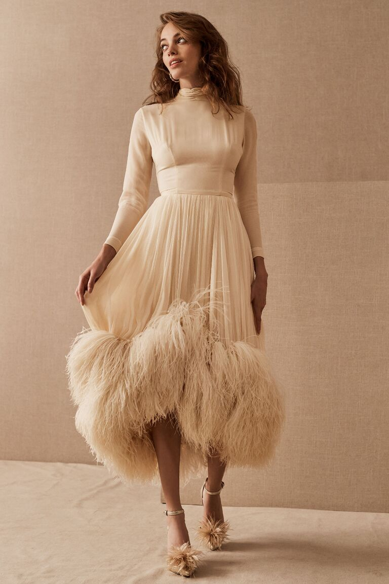 Vintage wedding dress with silk 3/4-length sleeve bodice and high-low skirt with ostrich feathered hemline