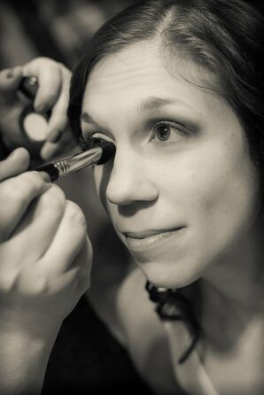 Bride Gets the Finishing Touches of Make Up