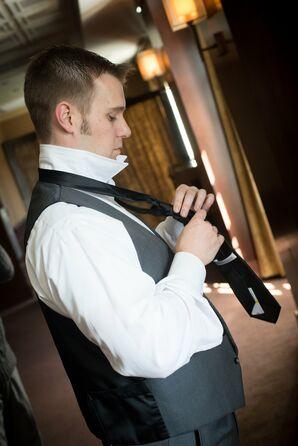 Groom Fastens his Formal Black Tie