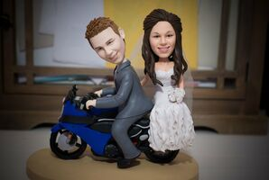 Bride and Groom Figurines on a Blue Motorcycle