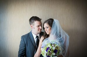 An Sweet Embrace with Bride and Groom with the Bridal Bouquet