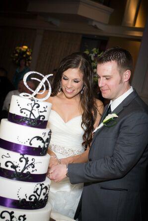 Bride and Groom Cut Their Elegant White Cake with Purple Trim