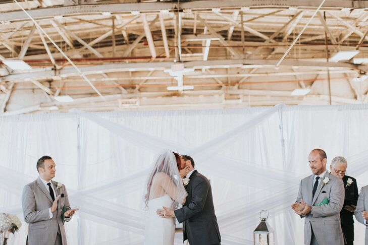 """""""For the ceremony, we created a backlight backdrop using pipe and drape,"""" Teresa says. """"Rail Yards Market was a blank slate with tons of character and historical significance, and we were so excited at the possibilities."""""""