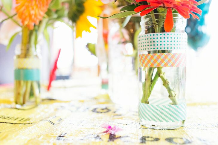 """""""All of the vases that held the flowers came from months of Jason and I recycling jars,"""" Shauna says. """"I embellished the jars with washi tape from Paper Source."""""""