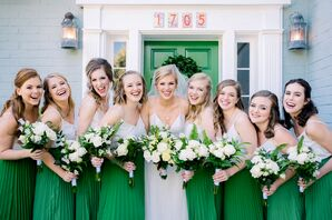 Bridesmaids with Green Gowns, Down Hairstyles and Bouquets