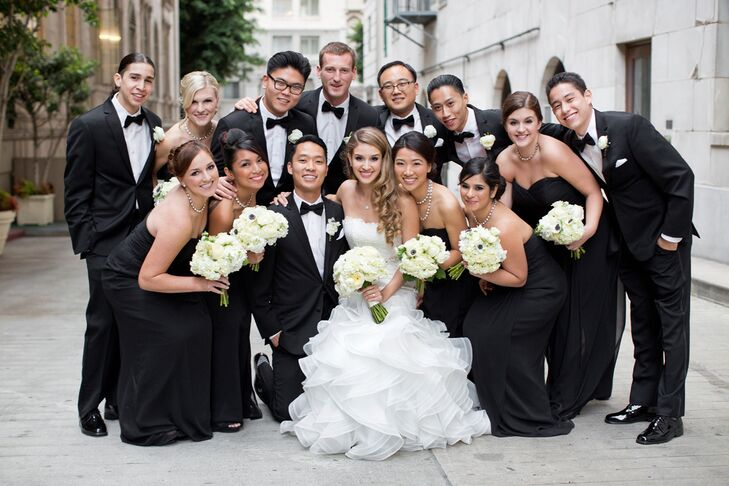 Huddled Bride and Groom With Wedding Party