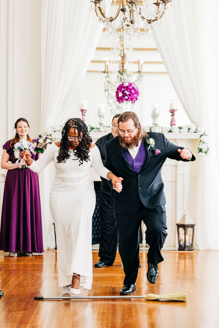 Bride and Groom Jumping the Broom at The Hotel Concord in North Carolina