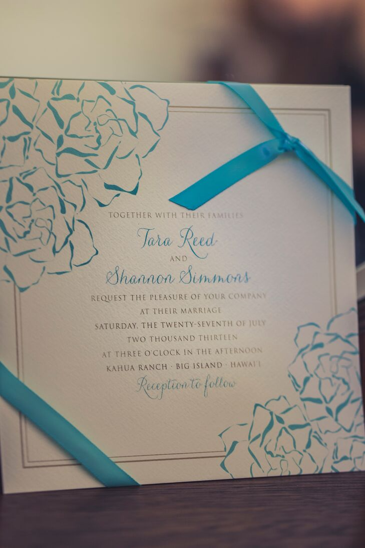 Wedding invitations were printed on simple white stationary with blue text and floral graphics. The invitations was wrapped in blue ribbon.