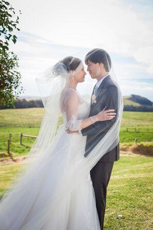 Intimate Shot Underneath Ivory Wedding Veil