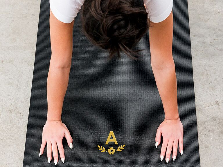 Black yoga mat with yellow monogram