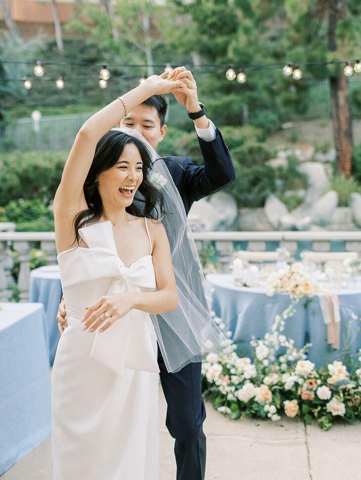 Couple Shares First Dance During Backyard Wedding
