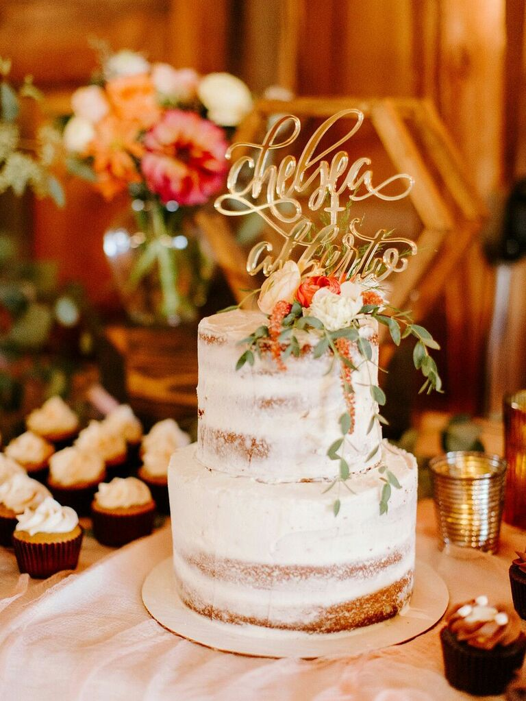 Two-tier semi-naked rustic wedding cake with glam gold cake topper and fresh flowers