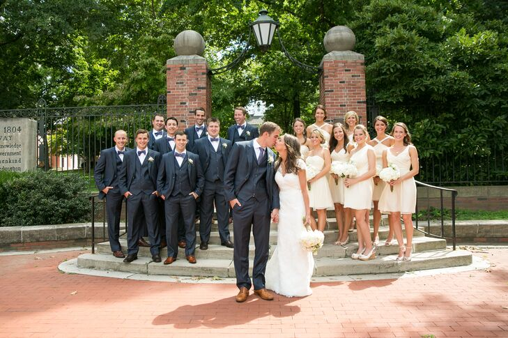 """""""The groom and groomsmen wore navy blue suits with matching ties and bowties while the bridesmaids wore ivory colored dresses of various styles,"""" says the couple."""
