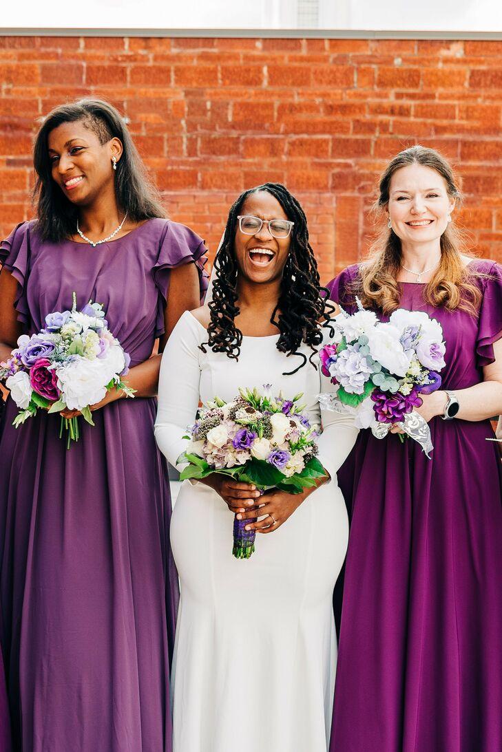 Bride With Bridesmaids Wearing Purple