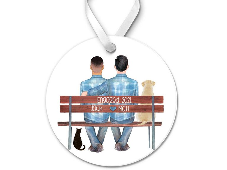 Personalized drawing of back's of couple sitting on bench on white circle ornament