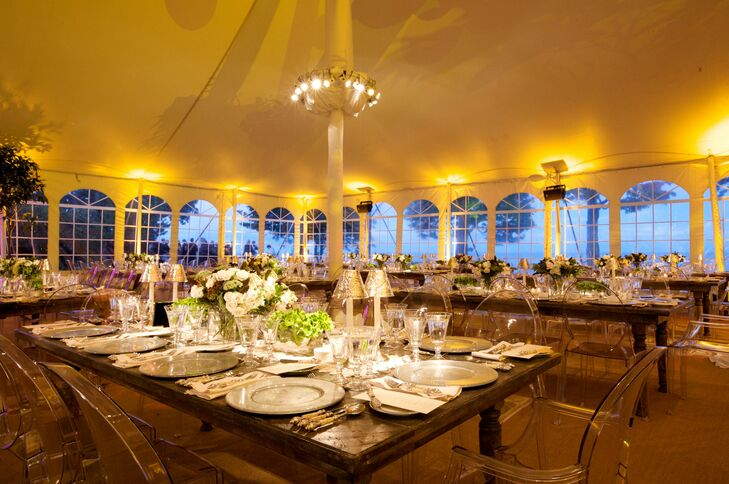 Farm tables and Louis Ghost Chairs were a bold pairing for their tented affair.