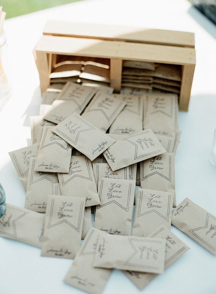 Jamie made a custom stamp for the seed packets, which they gave to guests as favors, in addition to monogrammed tree round ornaments and honey sticks.