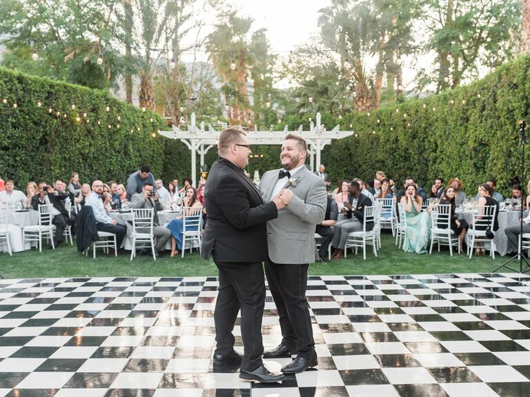 Grooms during first dance at outdoor wedding reception