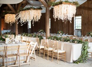 """For their summer """"I dos,"""" Casey Nowak and Brenden Goldman planned a sophisticated soiree with undeniable Lowcountry flair.<br><br>When it came to choo"""