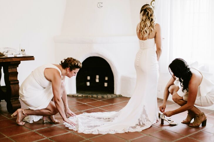 """Mira's Jinza Couture gown had romantic, bohemian elements, like delicate lace. """"My dress was a lace fitted bodice with spaghetti straps and a curve-hugging matte skirt—all one piece—that fit like a glove yet allowed me to move, dance and hug with comfort,"""" Mira says."""