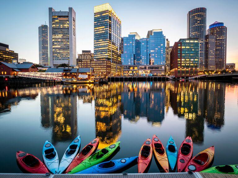 Kayaks on lake looking out across Boston skyscrapers