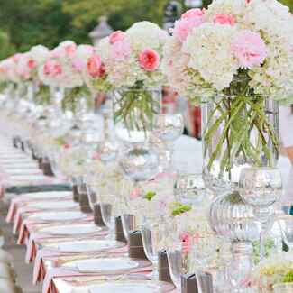 Pink and white wedding reception seating
