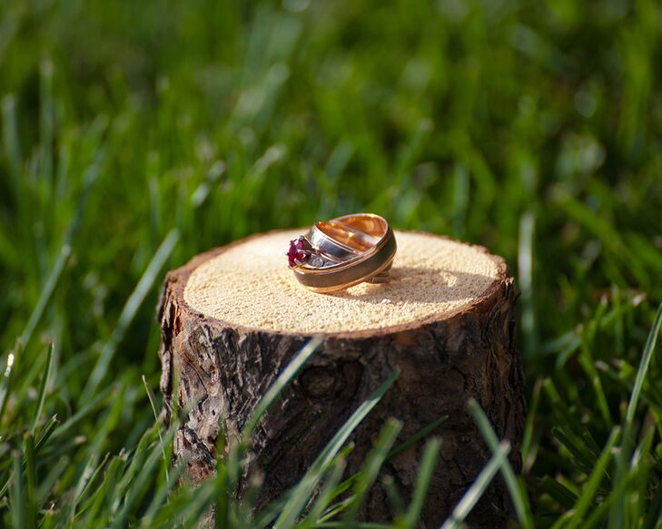Eric proposed with a teardrop ruby ring. They paired it with a simple gold band at the wedding.