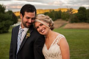 Groom in Blue Tie and Succulent Boutonniere and Bride in Braided Updo