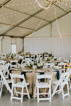 Tented Reception with White Folding Chairs