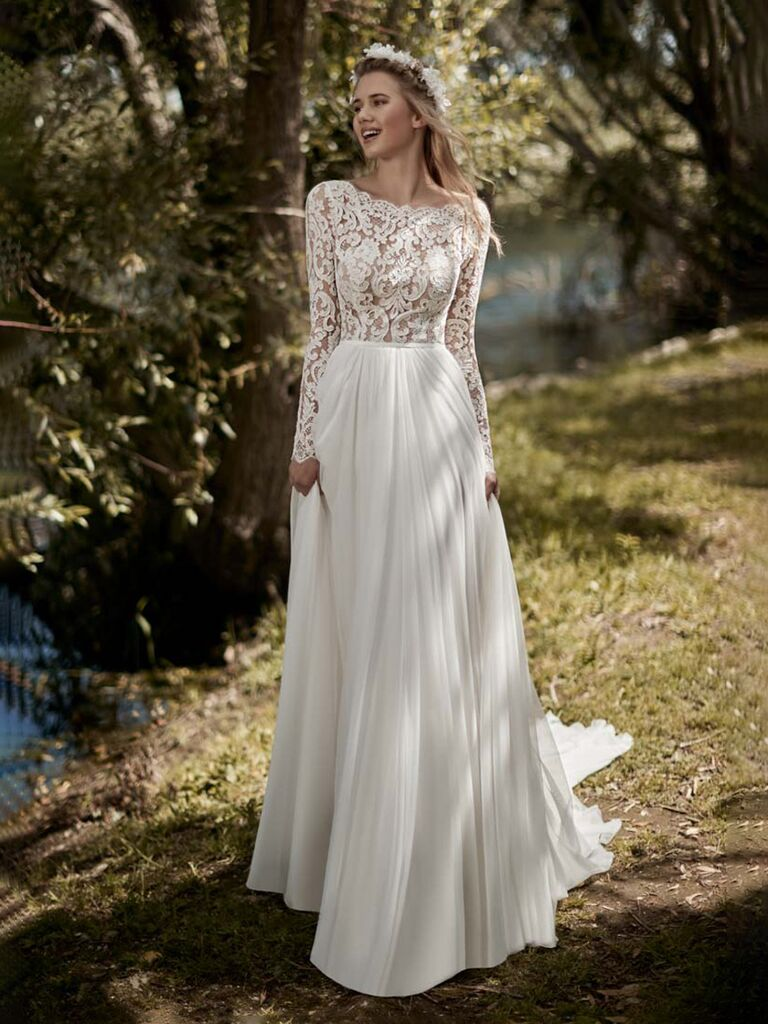 kleinfled bridal white a line wedding dress with lace top with high neckline and flowy pleated skirt