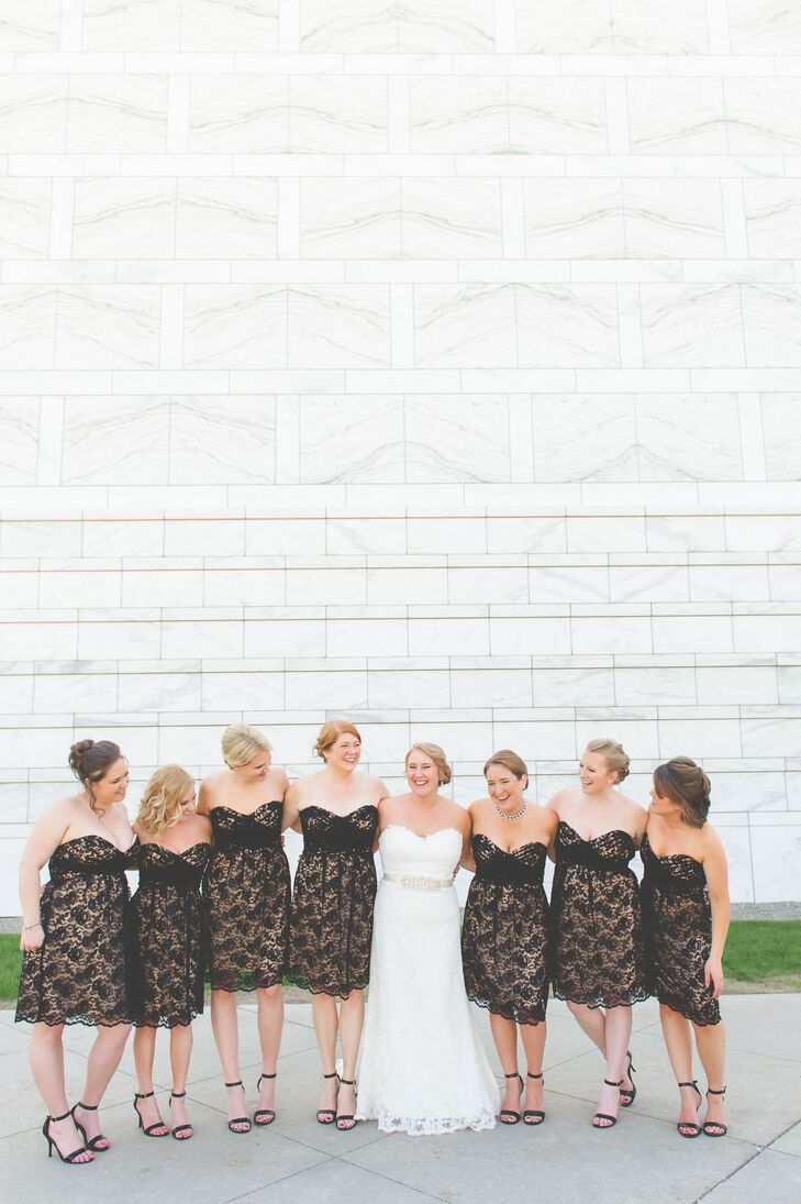 Black lace Amsale bridesmaid dresses popped against Laurie's all-white Eugenia Couture gown.