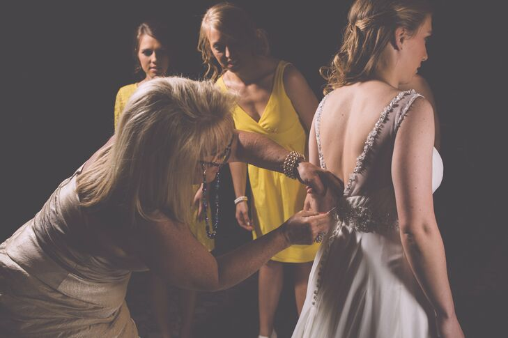 The bride chose her gown from Atlas Bridal. The main selling point of this dress for her was how comfortable it was. She was able to dance in it with ease and the illusion neckline and sparkly beading added a touch of glamour.