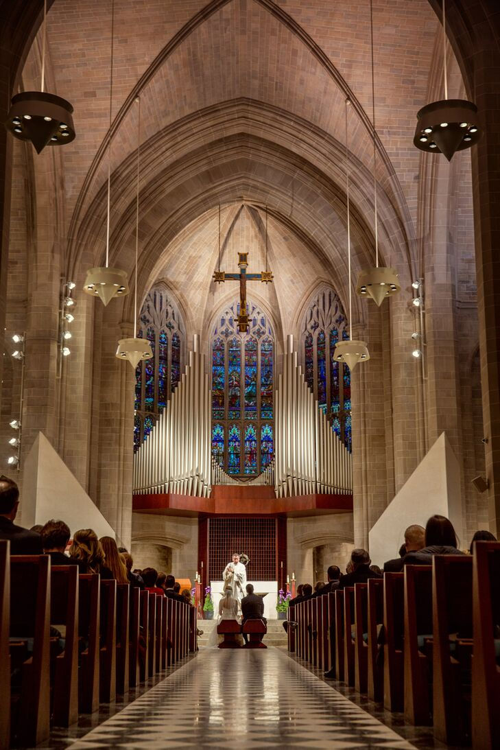 """The couple tied the knot at the Cathedral of the Most Blessed Sacrament in Detroit. """"It's a beautiful, traditional, Catholic church with this long aisle and plenty of seating,"""" Michelle explains."""