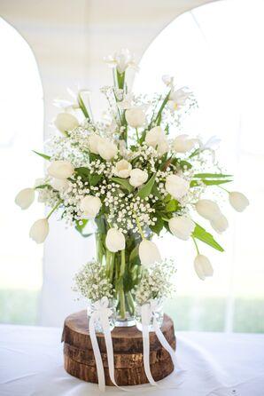 White Flower Arrangement on Wood Slab