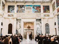 Wedding guests at formal wedding ceremony