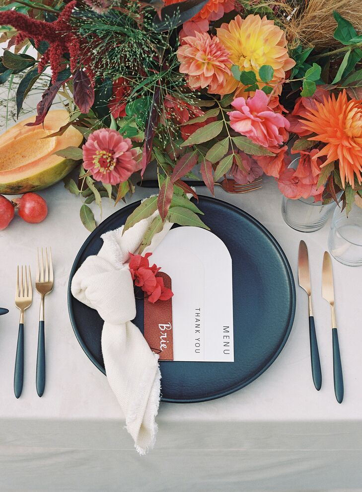 Place Setting With Matte Black Plates and Leather Place Cards