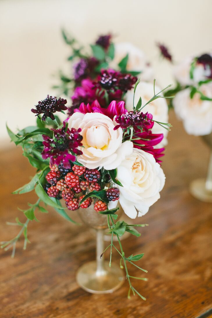 Michael Daigian Designs took the couple's romantic vineyard inspiration and ran with it for the florals, creating inspired arrangements of rich burgundy, wine and deep purple blooms with playful additions like raspberries, pomegranates and more.