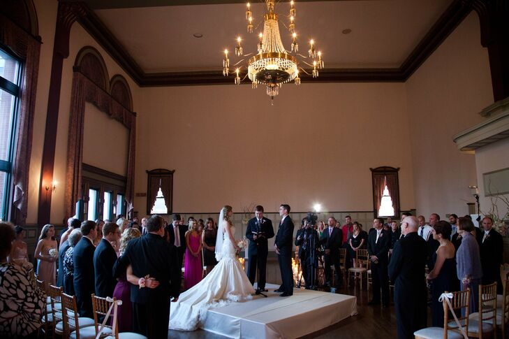 With 160 guests, Clint and Kelly hoped for intimate nuptials by creating their ceremony in the round. Their dear friend officiated the wedding as they exchanged their vows under the venue's historic chandelier.
