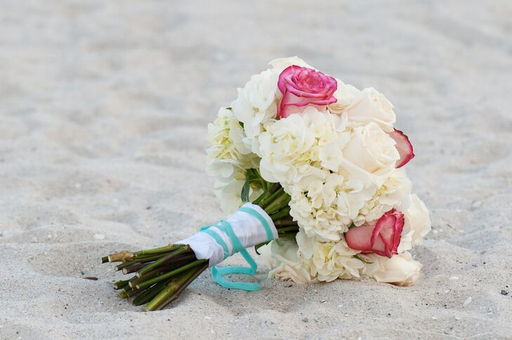 Jen carried a white hydrangea, white rose and pink rose bouquet arranged by Julie Miner Events. It was wrapped with a spa blue and white ribbon.