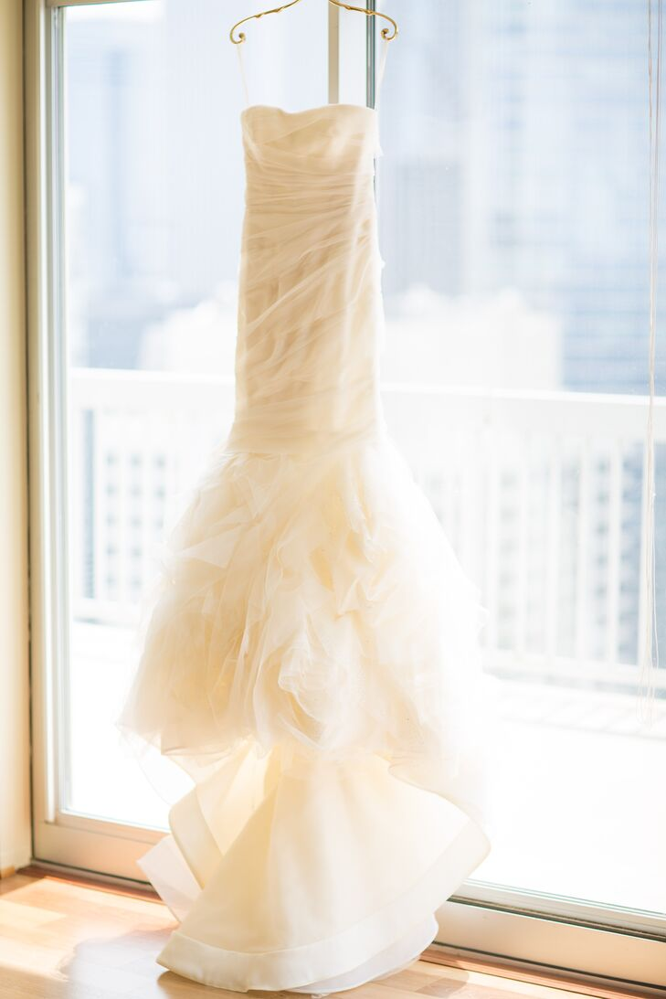 """For her walk down the aisle, Emily donned an ivory Vera Wang design that incorporated French tulle and silk organza. """"We wanted our attire to feel timeless and classic in order to match the formality of our black-tie-optional wedding,"""" she says."""