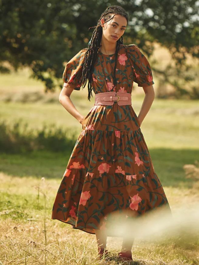 Brown midi dress with pink floral print and oversized puff sleeves with belted waist