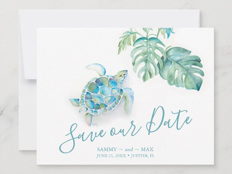 Turtle and tropical leaves graphics with 'Save our date' in loopy blue script