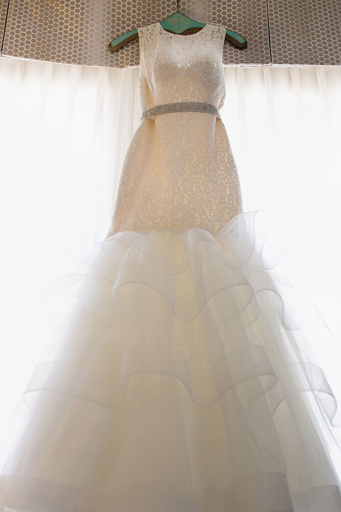 A lace mermaid-cut dress with layers of tulle on the bottom was the perfect choice for Paige, who wanted something classic and special.