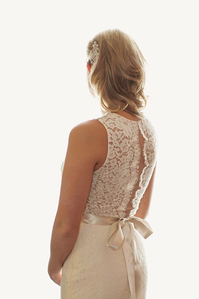 Paige's dress had a crew neckline with an open back, a modern twist on a classic design.