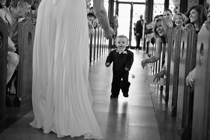 """It was special to the bride to have all the family involved in the wedding, so she wanted her nephew to be the ring bearer. """"He actually only learned to walk one week before the wedding, so his trip down the aisle was a little all over the place, but he made it and looked so cute doing it!"""""""