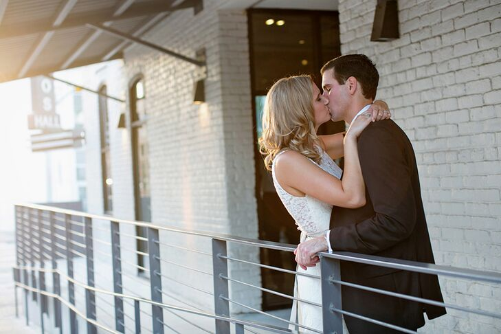 John and Paige stepped away from the reception to sneak a kiss outside the white brick walls of Brazos Hall.