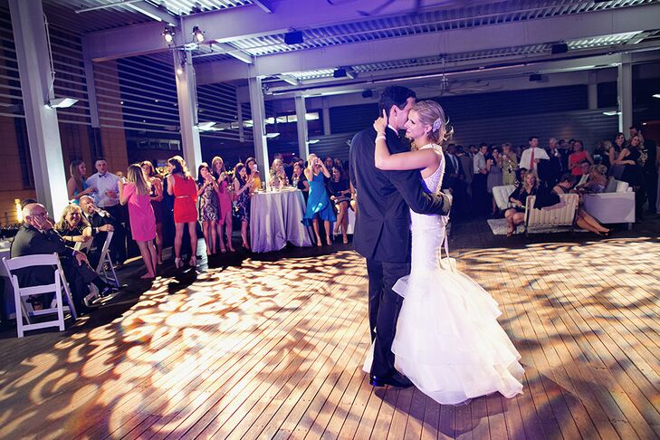 """The bride and groom were touched by lyrics of John Legend's """"Stay with You,"""" so they chose this song for their first dance. John and Paige have very different tastes in music, so they were excited to find a song they both agreed upon for their first dance."""