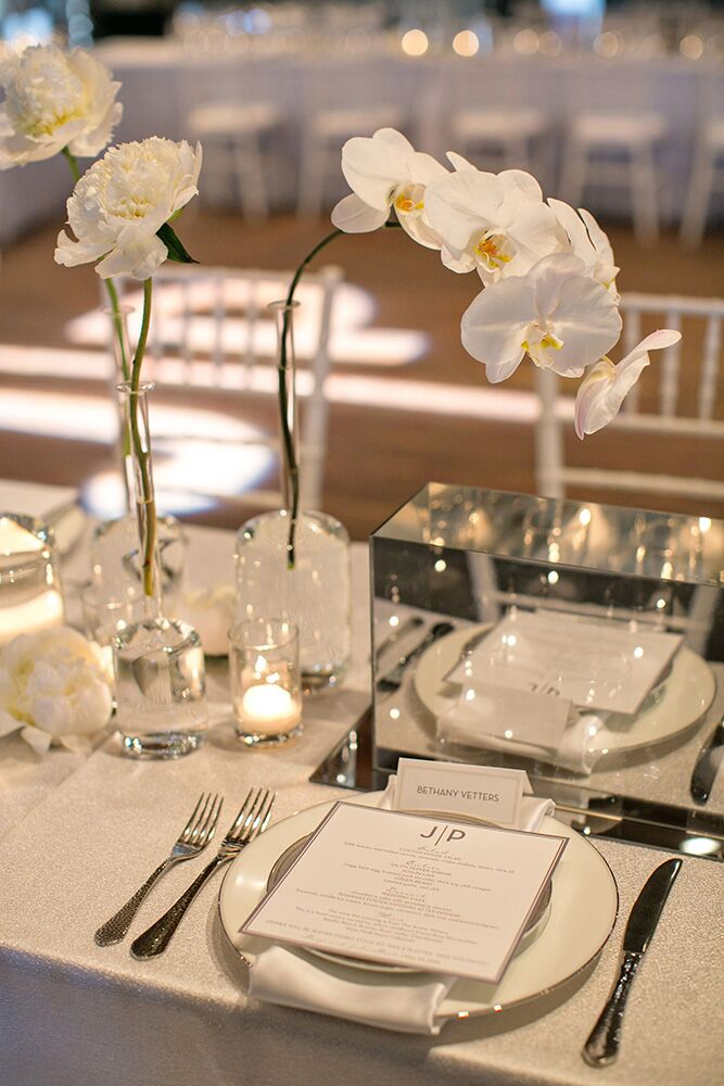 The reception menu featured the couple's custom JP logo they placed on all stationery and signage. Each table had a unique composite of chairs, silverware, candlelight and floral.