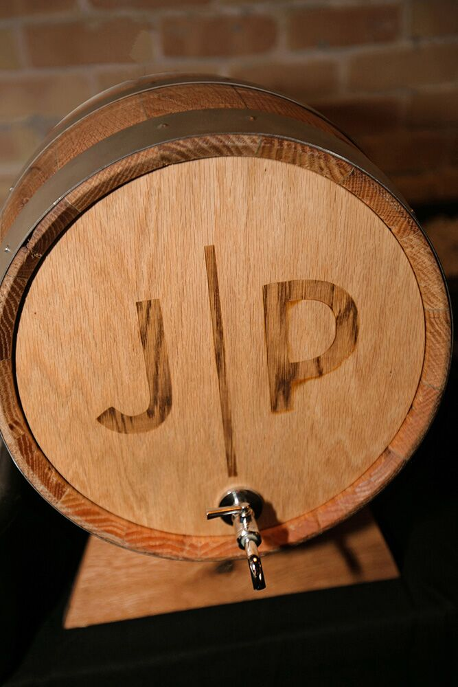 John and Paige's custom JP logo printed onto a keg barrel added a personal touch to the celebration's libation station.