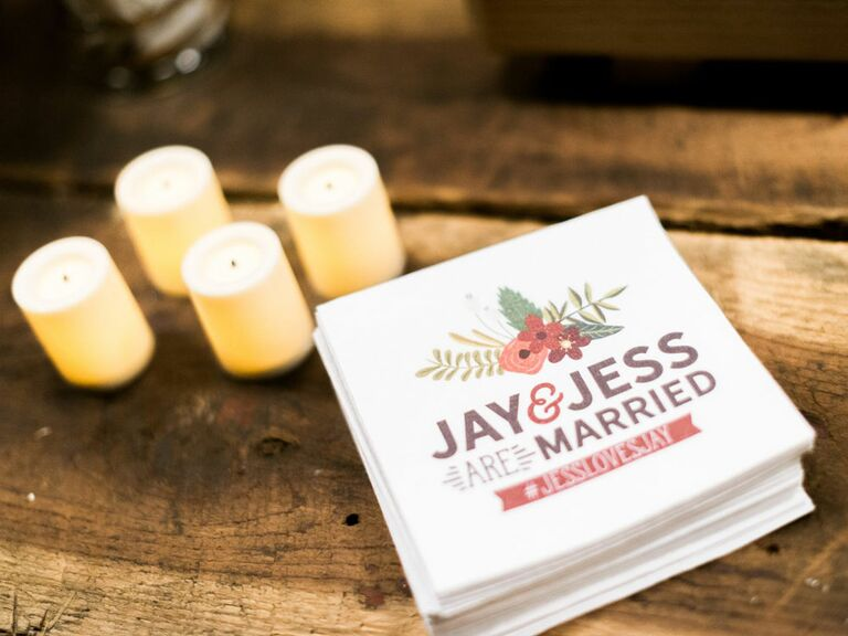 Cocktail napkins printed with wedding hashtag sign
